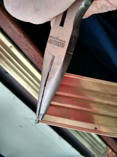 Mitering bronze weatherstripping