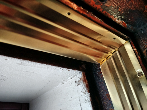 Bronze weatherstripping miter match