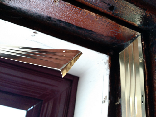 Mitering bronze weatherstripping together