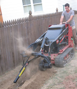 Using the Toro Dingo to trench for electric lines.
